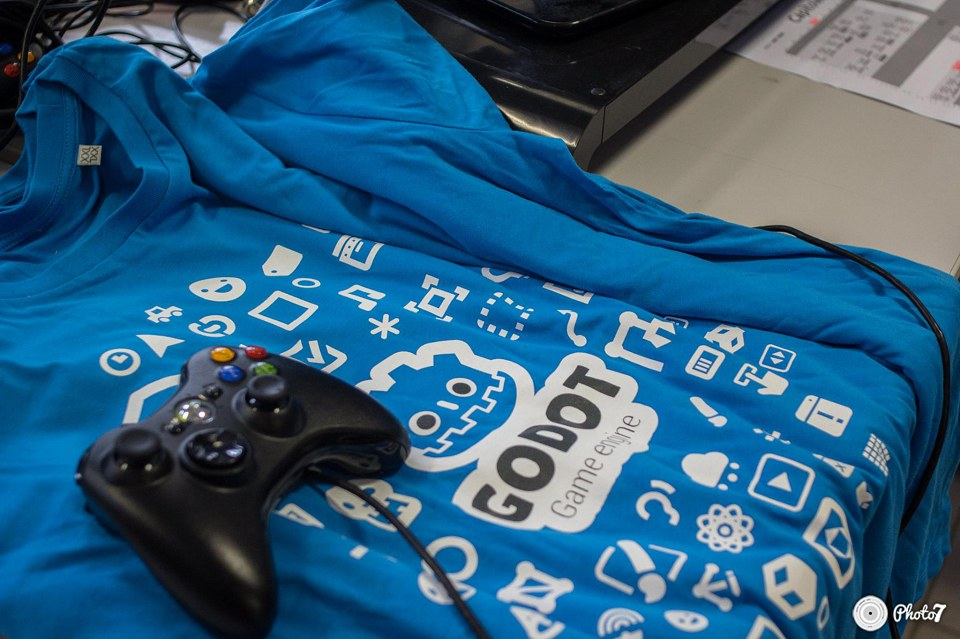A stack of official Godot shirts at our stand